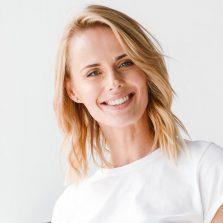 smiling-businesswoman-holding-folder-8PBUAH4.jpg